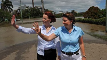 Prime Minister Julia Gillard and Queensland Premier Anna Bligh inspect a flooded neighbourhood near the famous rum distillery in Bundaberg.