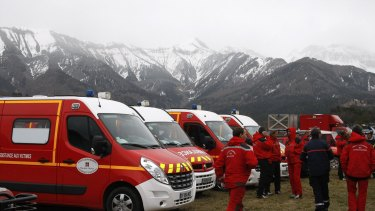 Rescue workers and ambulances ready to provide assistance at the Germanwings crash site near Seyne les Alpes on Tuesday.