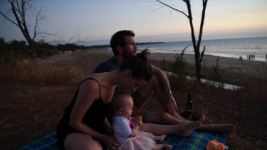 Bethan and Johhny McElwee watch the sun set at Dripstone Cliffs in Darwin on Aviana's first birthday.