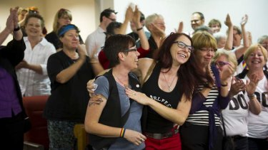 Celebration: The public gallery applaud the passing of the same sex marriage bill in the ACT.