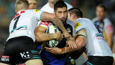 James Tamou does the hard yards for the Cowboys on a night when he ran 199 metres against the Panthers.