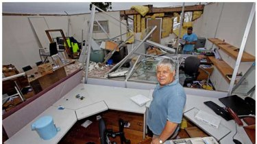 Chris Tsiavis in his flooded Laverton office.