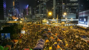 Enthralled: Tens of thousands of protesters gather to listen to the talks at the main protest site in Hong Kong.