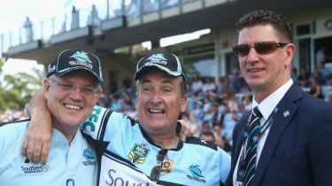 Sharks chairman Damian Keogh (right), pictured with Federal Treasurer Scott Morrison and former Sharks ground announcer Glenn Wheeler.