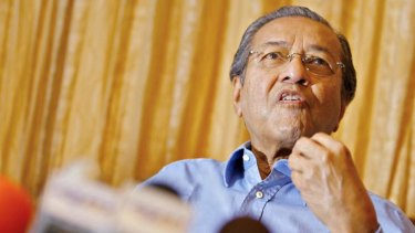 Still outspoken: Former prime minister Mahathir Mohamad talks to journalists at his residence on the outskirts of Kuala Lumpur.