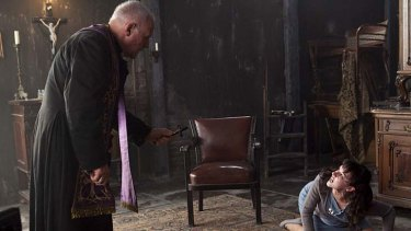 """Rites and wrongs ... Father Lucas (Hopkins) tries his best to remove satan from a suffering young woman, in a film that """"adequately entertains""""."""