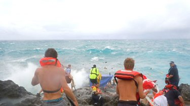 Saving lives ... Christmas Islanders join the rescue attempt.