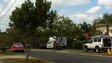 A removal truck at a house on Douglas Street, in Logan.