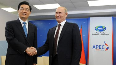 Russian President Vladimir Putin, right, meets with Chinese President Hu Jintao during the APEC summit in Vladivostok.