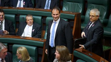 Whack! ... Frankston MP Geoff Shaw leaves Parliment yesterday.