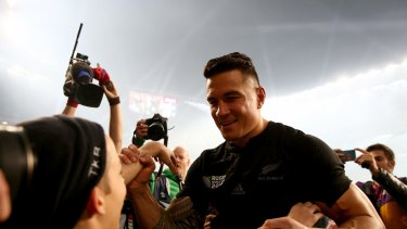 Magic moment: Sonny Bill Williams gives his World Cup winning medal to young fan Charlie Lines.