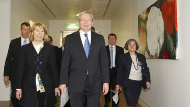 Kevin Rudd leads his supporters into today's Labor caucus meeting.