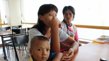 Khine Zin Soe, 24, centre, worked in a shrimp shed when she was pregnant and the owner forced her to work peeling shrimp even when she miscarried. With her are her husband, Kyaw Kyaw Aung, and her son, Htet Wai Yan.