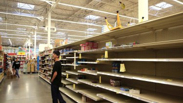 Logan Garcia looks for last-minute supplies at a grocery store in Corpus Christi, Texas.