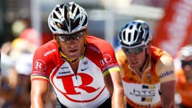 Lance Armstrong crosses the finish line ahead of Matt Goss during stage two of the 2011 Tour Down Under.