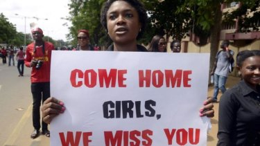 A woman carries placard to press for the release of missing Chibok school girls during a rally by civil society in Lagos on Sunday.