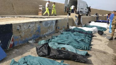 Overwhelmed: Bodies of the drowned migrants are lined up in the port of Lampedusa.