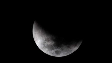 The moon is eclipsed over Sydney.