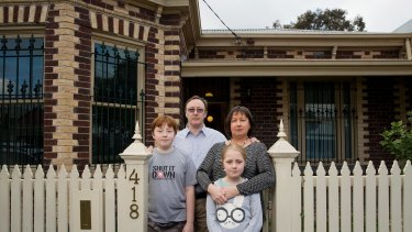 Howard and Gillian Tuxworth, with children Harry and Molly. Their Collingwood home is set to be levelled for a temporary road for East West Link construction vehicles.