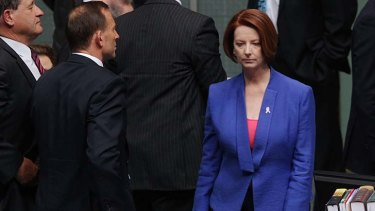 Political rivals ... Julia Gillard walks past Tony Abbott.