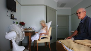 Michael Sabey sits with his mother Catherine, 92, in her room at Regis Bayside Gardens.