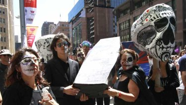Protesters in the Occupy Sydney march carry a coffin during today's rally.