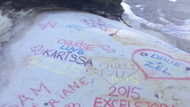 Visitors have been making their mark by chalking names on the rock in bright colours.