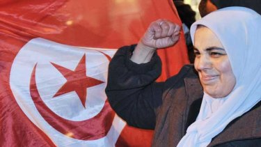 A Tunisian woman celebrates after the announcement that Zine El Abidine Ben Ali has quit as president and fled to Saudi Arabia.