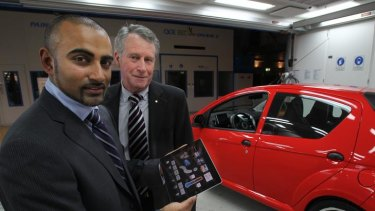 Vikash Rugoobur and Dr Laurie Sparke, with the EDay electric car and the iPad controller.