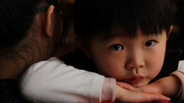 Separated from Charlotte Chou because of her incarceration ... Lincoln, 4, with his sister. He has spoken to his mother only once.