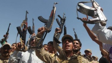 Call to arms:  Shiite volunteers take up arms provided by the government to fight the ISIL insurgency.