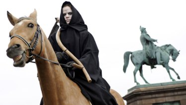 A woman dressed as Death, of the Four Horsemen of the Apocalypse at a Greenpeace demonstration in Copenhagen.
