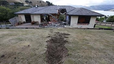 A giant boulder  crashed through a house during Tuesday's earthquake near Lyttelton, on the outskirts of Christchurch.