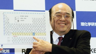 Kosuke Morita of Riken Nishina Center for Accelerator-Based Science points out the new elements added to the periodic table of the elements during a press conference.