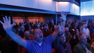 Singing praises ... members of the congregation.