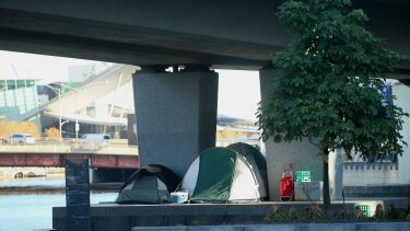 Tents erected underneath a railway overpass near the Yarra River at Enterprize Park.