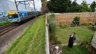 Michelle Clarke in the backyard of her Carnegie home which backs on to the rail tracks where sky rail will be built.