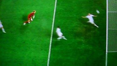 John Terry runs back towards goal as goalkeeper Joe Hart looks on.