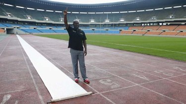 Sprinter Ben Johnson of Canada poses after running next to a petition laid out on the track at the Seoul Olympic Stadium on Tuesday.