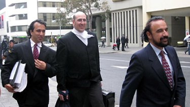 Zubair Sayed (left), lawyer Andrew Skerritt and Anwar Sayed leave court after being acquitted.