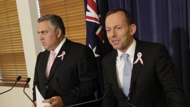 Tony Abbott and Joe Hockey respond to the budget update at Parliament House in Canberra.
