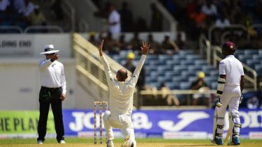 Lyon rampant: Australia's Nathan Lyon successfully appeals for leg-before against West Indies' Darren Bravo on day two of the second Test at Sabina Park, Jamaica.