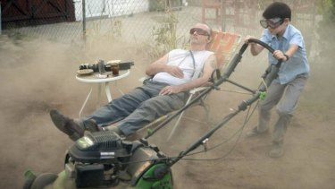 Lawn story: Vincent (Bill Murray) puts his neighbour's son Oliver (Jaeden Lieberher) to work.