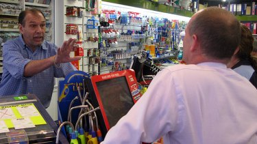 A shopkeeper talks to Campbell Newman in Ashgrove.