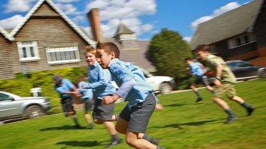 Rough and tumble ... boys are encouraged to learn through physical play at Tudor House.