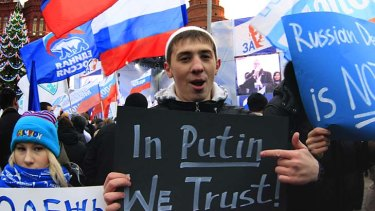 Supporters in Moscow show their backing for the ruling United Russia party.