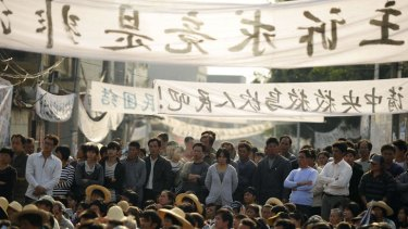 Residents of Wukan rally to demand the government take action over illegal land grabs and the death of a local leader while in police custody.