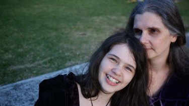 Grateful ... Megan Hitchens with her daughter Jessica, 12, who attended Wyong Public School, which faces funding cuts.