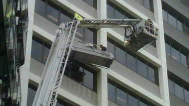 Refusing assistance: the stranded window washers.