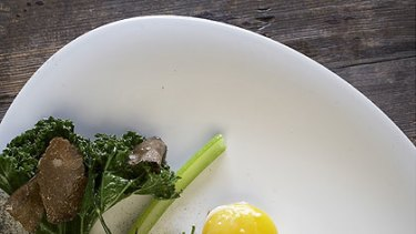 Hay-smoked egg with hay cinders.